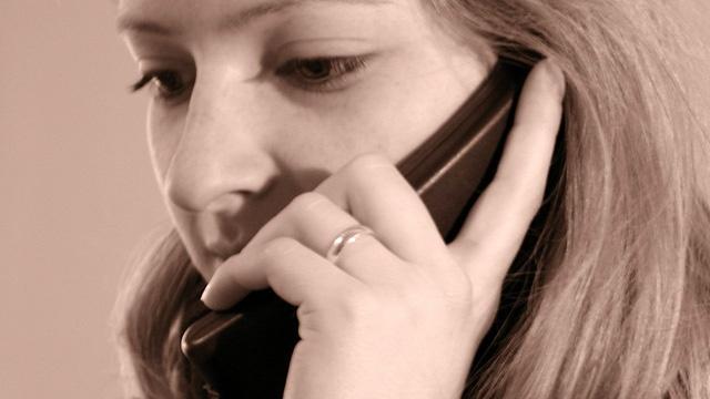 Woman on landline phone_3535540243580513-159532