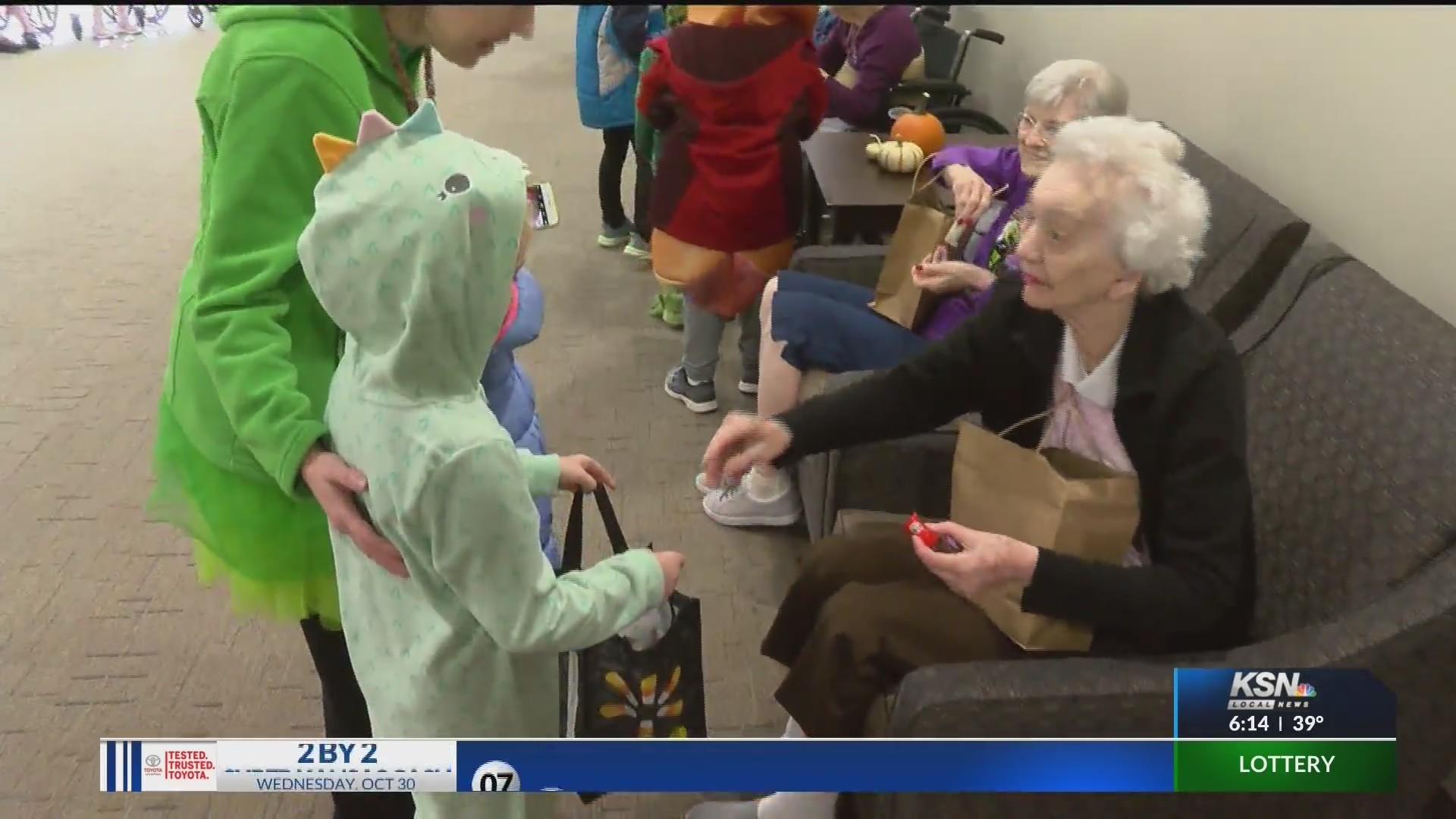 students visit nursing home residents